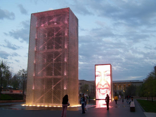 Twin 50-foot glass block towers with Art Institute in background